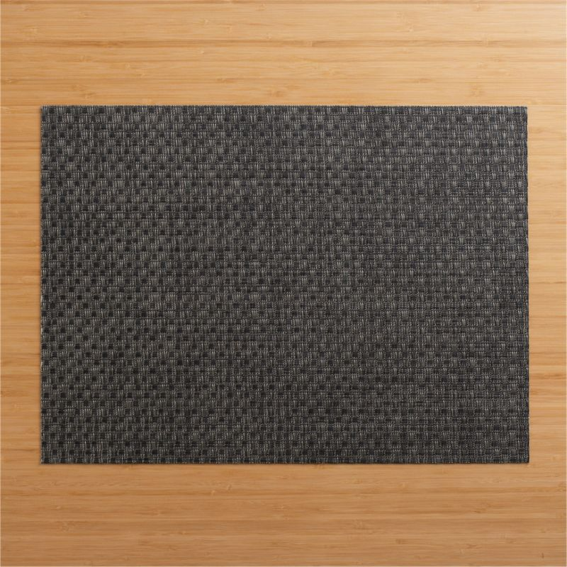 Modern graphite vinyl textures the table with our exclusive Chilewich® basketweave placemat.<br /><br /><NEWTAG/><ul><li>100% vinyl</li><li>Clean with a damp cloth</li><li>Made in USA</li></ul><br />