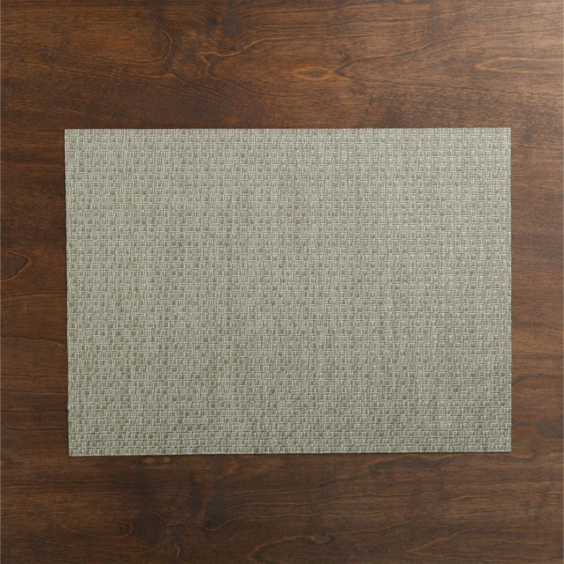 Chic silver vinyl textures the table in our exclusive Chilewich® woven placemat.<br /><br /><NEWTAG/><ul><li>100% woven vinyl</li><li>Hand wash</li><li>Made in USA</li></ul>