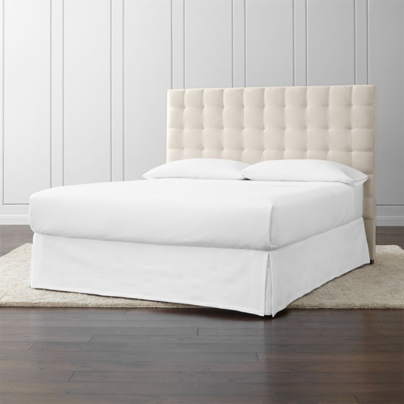 Lining up on the grid as a tall presence for the contemporary bedroom, our Quadrant California king headboard is wrapped in a soft, cotton-poly blend fabric. Buttonless tufting detail adds casual definition and visual interest. The Quadrant California King Headboard is a Crate and Barrel exclusive.<br /><br /><NEWTAG/><ul><li>Frame is benchmade in the USA with certified sustainable hardwood that's kiln-dried to prevent warping</li><li>Soy-based polyfoam cushioning</li><li>Solid maple legs with brown finish</li><li>Headboard requires a bed frame (sold separately)</li><li>When attached to Crate and Barrel bed frame no additional hardware required; accommodates mattress and box spring (sold separately)</li><li>Non-Crate and Barrel bed frame may require a Modi-Plate Kit (sold separately)</li><li>Material origin: see swatch</li><li>Made in North Carolina, USA</li></ul>