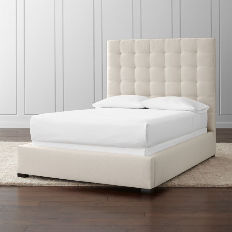 The grid goes plush in tufted headboard that squares up fresh and modern on clean linear frame that is wrapped in a soft neutral cotton/poly blend. Mattresses and foundations available (sold separately).<br /><br />After you place your order, we will send a fabric swatch via next day air for your final approval. We will contact you to verify both your receipt and approval of the fabric swatch before finalizing your order.<br /><br /><NEWTAG/><ul><li>Certified sustainable kiln-dried hardwood frame</li><li>Soy-based foam and fiber cushioning</li><li>Solid maple legs have a Lautrec finish</li><li>Slat system with support system</li><li>Accommodates a mattress and foundation</li><li>Made in North Carolina, USA</li></ul>