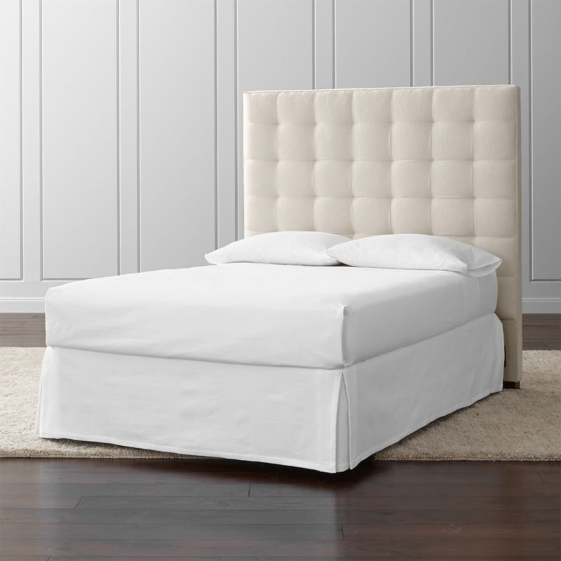 Lining up on the grid in a tall presence for the contemporary bedroom, our Quadrant full headboard is wrapped in a soft, cotton-poly blend fabric. The headboard's buttonless tufting adds casual definition and visual interest. The Quadrant Full Headboard is a Crate and Barrel exclusive.<br /><br /><NEWTAG/><ul><li>Frame is benchmade in the USA with certified sustainable hardwood that's kiln-dried to prevent warping</li><li>Soy-based polyfoam cushioning</li><li>Solid maple legs with brown finish</li><li>Headboard requires a bed frame (sold separately)</li><li>When attached to Crate and Barrel bed frame no additional hardware required; accommodates mattress and box spring (sold separately)</li><li>Non-Crate and Barrel bed frame may require a Modi-Plate Kit (sold separately)</li><li>Material origin: see swatch</li><li>Made in USA</li></ul>