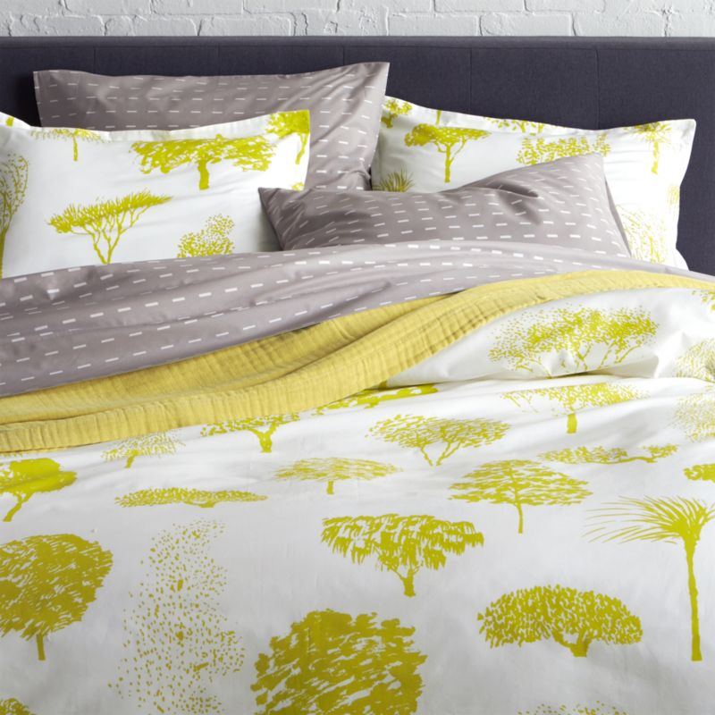 """Global forest plants citron silhouettes of the world's trees on crisp white cotton percale bedding, artfully rendered in designer Fujiwo Ishimoto's painted design. Inspired by his observations of nature in many settings, the pattern is named Rantapuisto, a Finnish word meaning """"beach park."""" Reversible duvet cover has hidden button closure and interior fabric ties to keep the duvet in place. Duvet insert available.<br /><br /><NEWTAG/><ul><li>Designed by Fujiwo Ishimoto</li><li>100% cotton percale</li><li>300-thread-count</li><li>Hidden button closure and interior fabric ties</li><li>Machine wash cold, tumble dry l"""