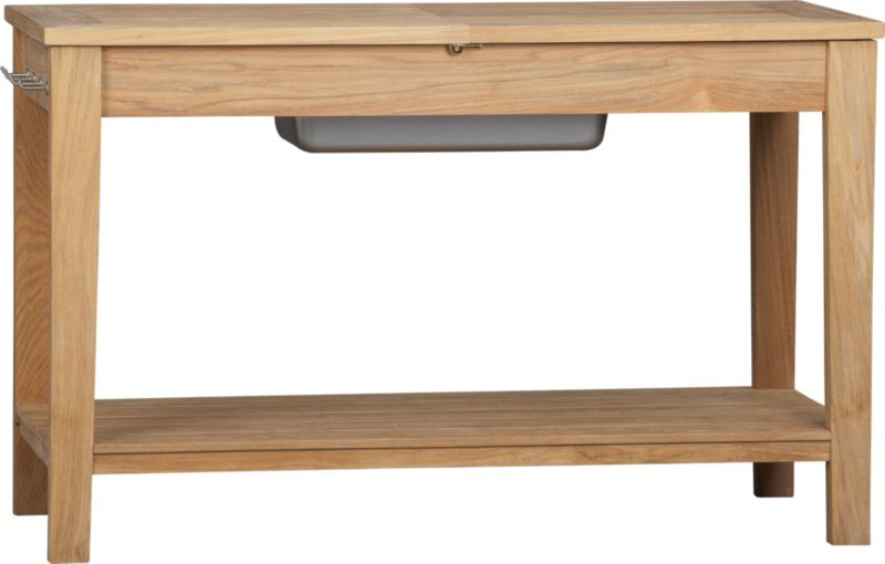 Our eco-friendly Regatta teak collection cuts a clean, classic profile in a bold wide-slat design, handcrafted with mortise-and-tenon joinery and finished with galvanized steel hardware. Console table top unlocks and opens to a galvanized steel container perfect for entertaining, gardening or storage. Four stainless steel side storage hooks. Quality plantation-grown teak is supported by the TFT, a nonprofit organization that promotes responsible forest conservation. We recommend allowing the unfinished teak to weather to a silvery grey. To maintain the natural color, use our Golden Care® Teak Protector. Regatta dining collection also available.<br /><br /><NEWTAG/><ul><li>Solid teak harvested from plantations working with TFT</li><li>Unfinished</li><