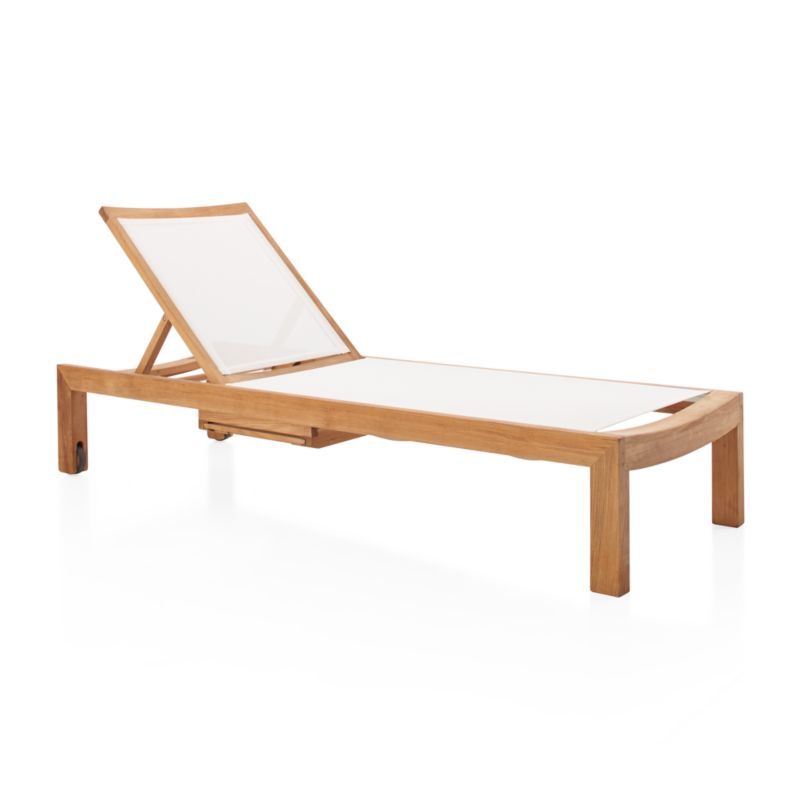 Our exclusive Regatta outdoor chaise lounge cuts a clean, classic profile in a bold wide-slat design handcrafted in the world's highest quality teak. Grade A plantation-grown teak Certified by the Forest Stewardship Council (FSC), the environmental gold standard, frames flexible, UV- and fade-resistant white mesh inserts. <NEWTAG/><ul><li>Handcrafted</li><li>Solid FSC-certified teak</li><li>Unfinished</li><li>White Batyline ® synthetic mesh inserts</li><li>Mortise-and-tenon joinery</li><li>Stainless steel hardware</li><li>Adjusts to 4 positions, including flat</li><li>Two rear wheels</li><li>Fade- and mildew-resistant Sunbrella acrylic</li><li>Foam cushion fill</li><li>Fa