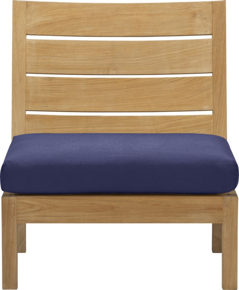 Our new eco-friendly Regatta teak lounge collection cuts a clean, classic profile in a bold wide-slat design, handcrafted with mortise-and-tenon joinery and finished with galvanized steel hardware. Modular armless chair sits alone or configures with its sectional counterparts. Quality plantation-grown teak is supported by the TFT, a nonprofit organization that promotes responsible forest conservation. We recommend allowing the unfinished teak to weather to a silvery grey. To maintain the natural color, use our Golden Care® Teak Protector. Cushion is fade- and mildew-resistant Sunbrella acrylic in indigo blue. Regatta dining collection also available.<br /><br /><NEWTAG/><ul><li>Solid teak harvested from plantations working with TFT</li><li>Unfinished</li><li>Mortise-and-tenon joinery</li><li>Stainless steel hardware</li><li>Fade- and mildew-resistant Sunbrella acrylic</li><li>Polyester batting and foam cushion fill</li><li>Spot clean the cushion cover</li></ul><br />