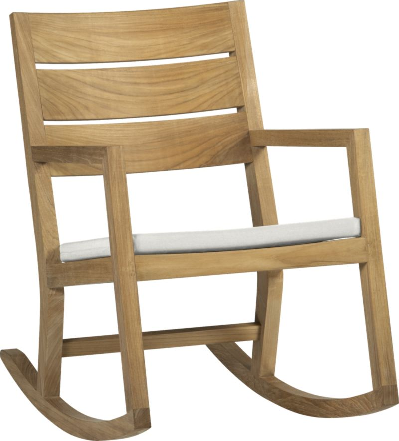 Our eco-friendly Regatta teak dining collection cuts a clean, classic profile in a bold wide-slat design. Mid-size rocking chair is handcrafted of quality plantation-grown teak supported by the TFT, a nonprofit organization that promotes responsible forest conservation. We recommend allowing the teak to weather to a silvery grey. To maintain the natural color, use our Golden Care® Teak Protector. Optional cushion is fade- and mildew-resistant Sunbrella® acrylic in warm white sand.<br /><br /><NEWTAG/><ul><li>Solid teak harvested from plantations working with TFT</li><li>Mortise-and-tenon joinery</li><li>Stainless steel hardware</li><li>Cushion is fade- and mildew-resistant Sunbrella acrylic</li><li>Polyester batting and foam cushion fill</li><li>Cushion is secured with fabric tab fasteners</li><li>Spot clean the cushion cover</li><li>Made in USA</li></ul>