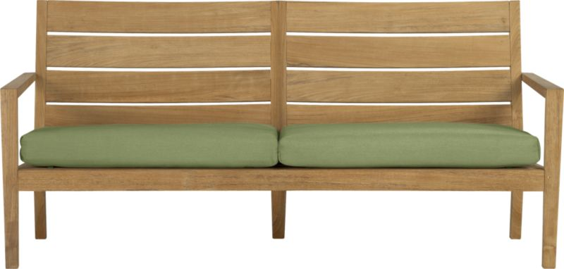 Our eco-friendly Regatta teak lounge collection cuts a clean, classic profile in a bold wide-slat design. Relax on a full-size sofa with sleek arms and comfortable angled backs. All pieces are handcrafted of plantation-grown teak supported by the TFT, a nonprofit organization that promotes responsible forest conservation. We recommend allowing the unfinished teak to weather to a silvery grey. To maintain the natural color, use our Golden Care® Teak Protector. Cushions are fade- and mildew-resistant Sunbrella acrylic in cilantro green. Regatta dining collection also available.<br />After you place your order, we will send a fabric swatch via next day air for your final approval. We will contact you to verify both your receipt and approval of the fabric swatch before finalizing your order.<br /><br /><NEWTAG/><ul><li>Solid teak harvested from plantations working with TFT</li><li>Unfinished</li><li>Mortise-and-tenon joinery</li><li>Stainless steel hardware</li><li>Cushion is fade- and mildew-resistant Sunbrella acrylic</li><li>Polyester batting and foam cushion fill</li><li>Cushion is secured with fabric tab fasteners</li><li>Spot clean the cushion cover</li><li>Made in Indonesia and Mexico </li></ul>