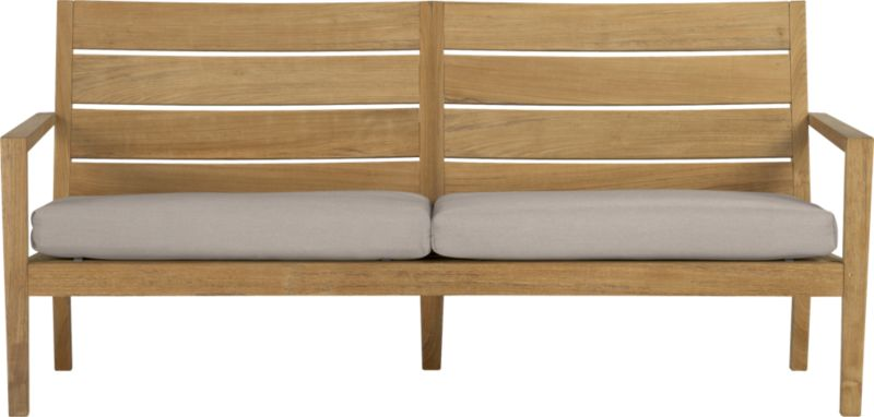 Our eco-friendly Regatta teak lounge collection cuts a clean, classic profile in a bold wide-slat design. Relax on a full-size sofa with sleek arms and comfortable angled backs. All pieces are handcrafted of plantation-grown teak supported by the TFT, a nonprofit organization that promotes responsible forest conservation. We recommend allowing the unfinished teak to weather to a silvery grey. To maintain the natural color, use our Golden Care® Teak Protector. Cushions are fade- and mildew-resistant Sunbrella acrylic in stone. Regatta dining collection also available.<br />After you place your order, we will send a fabric swatch via next day air for your final approval. We will contact you to verify both your receipt and approval of the fabric swatch before finalizing your order.<br /><br /><NEWTAG/><ul><li>Solid teak harvested from plantations working with TFT</li><li>Unfinished</li><li>Mortise-and-tenon joinery</li><li>Stainless steel hardware</li><li>Cushion is fade- and mildew-resistant Sunbrella acrylic</li><li>Polyester batting and foam cushion fill</li><li>Cushion is secured with fabric tab fasteners</li><li>Spot clean the cushion cover</li><li>Made in Indonesia and Mexico </li></ul>