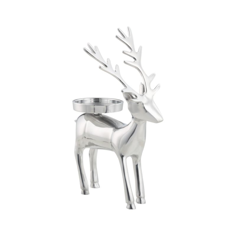 "Shiny reindeer balances a single pillar on its back to brighten faces as well as tables, mantels and holiday displays. Handmade of aluminum.<br /><br /><NEWTAG/><ul><li>Handmade</li><li>Aluminum</li><li>Pillar Candleholder accommodates a 3""-dia. pillar candle, sold separately</li><li>Wipe with damp soft cloth</li></ul>"
