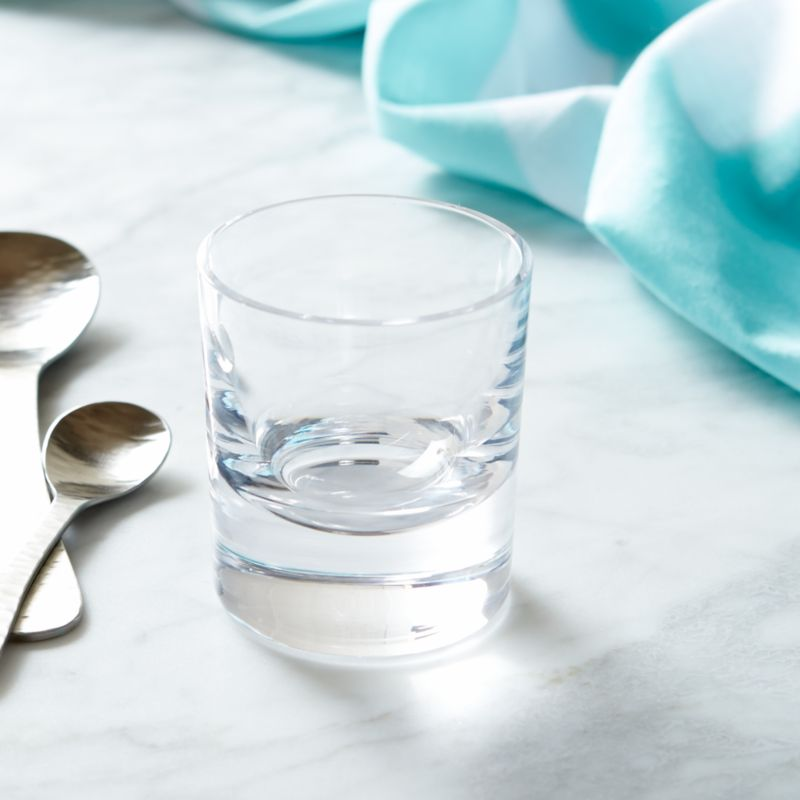Paola Navone's bold and expressive tableware collection recaptures the lively and energetic 1950s scene of the French Riviera. The inspiration is a cheerful world, remembering the flavors and scents of the sun-drenched Mediterranean. Earthy, elegant beverage glass in a timeless shape speaks to lingering, relaxing sips of icy cocktails or effervescent sodas. Each glass is handcrafted by skilled European glassmakers and stamped with the designer's signature fish logo.<br /><br /><NEWTAG/><ul><li>Designed by Paola Navone exclusively for Crate and Barrel</li><li>Handcrafted</li><li>Glass</li><li>Chip resistant</li><li>Hand