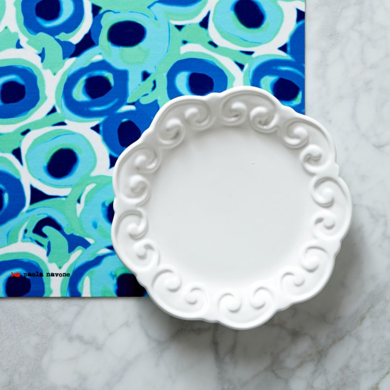 Paola Navone's bold and expressive tableware collection recaptures the lively and energetic 1950s scene of the French Riviera. The inspiration is a cheerful world, remembering the flavors and scents of the sun-drenched Mediterranean. Bold ceramic white plate transcends the ordinary, rimmed with textural flourishes of Baroque scrolls, each handmade.<br /><br /><strong>Please note:</strong> This plate will be discontinued in June 2014.<br /><br /><NEWTAG/><ul><li>Designed by Paola Navone exclusively for Crate and Barrel</li><li>Handcrafted</li><li>Earthenware</li><li>Dishwasher- and microwave-safe</li><li>Made in Portugal</li></ul>