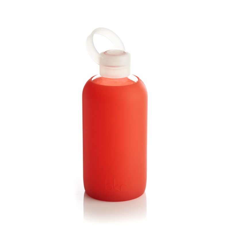 Glass water bottle gets a protective sleeve of soft silicone in attention-getting color for non-toxic, non-leaching, chemical-free pours of pure refreshment. Lightweight, sturdy and portable design features a small opening for spill-free sips.<br /><br /><NEWTAG/><ul><li>Glass</li><li>Silicone</li><li>Plastic cap</li><li>BPA- and phthalate-free</li><li>Food safe</li><li>Dishwasher-safe</li><li>100% recyclable</li><li>Made in China</li></ul>