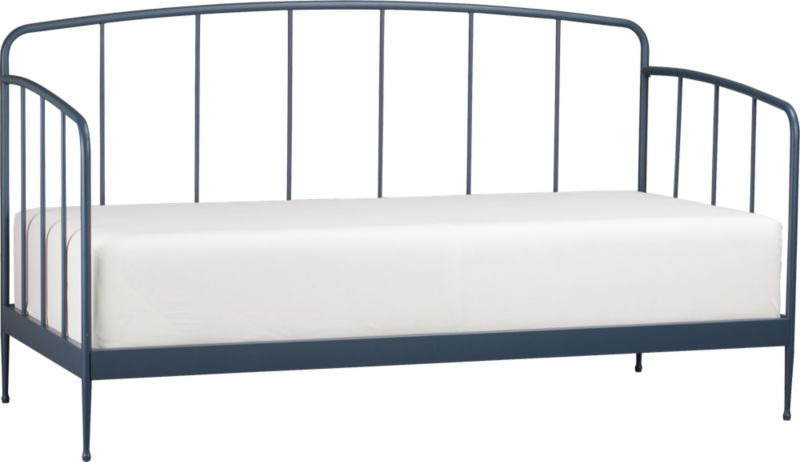 Clean, au courant styling updates the Victorian iron bed frame in modern tubular metal, minimally embellished with a gracefully arched headboard and footboard and a beautiful slate blue powdercoat finish. Foot detail on the tapered legs creates a floating effect. Accommodates a twin mattress, pair with matching trundle bed for spur-of-the-moment overnighters. Mattresses and coordinating trundle bed sold separately.<br /><br /><NEWTAG/><ul><li>Metal tube with blue powdercoat finish</li><li>Accommodates a twin mattress and trundle bed, sold separately</li><li>Slat system</li><li>Made in China</li>&