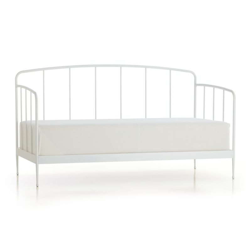 Clean, au courant styling updates the Victorian iron bed frame in modern tubular metal, minimally embellished with a gracefully arched headboard and footboard and a beautiful white powdercoat finish. Foot detail on the tapered legs creates a floating effect. Accommodates a twin mattress, pair with matching trundle bed for spur-of-the-moment overnighters. Mattresses and coordinating trundle bed sold separately.<br /><br /><NEWTAG/><ul><li>Metal tube with white powdercoat finish</li><li>Accommodates a twin mattress and trundle bed, sold separately</li><li>Slat system</li><li>Made in China</li></ul>