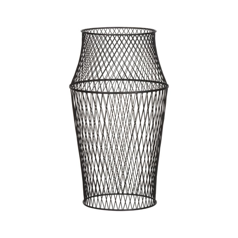 Black iron wire weaves an airy, wide-waisted column open to the imagination. Stand on either end to cage tomatoes, stand pots of cascading flowers or vine climbing plants. Sculptural form can also stand on its own as a contemporary work of art inside or out. Especially beautiful nesting our Jacoba Planters.<br /><br /><NEWTAG/><ul><li>Black iron wire</li><li>For indoor or outdoor use</li><li>Made in The Philippines</li></ul>
