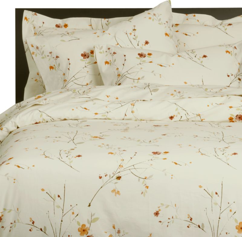 Ikebana inspiration for your personal space. A botanical pigment print in burnt oranges, greens and rust with brown branches is scattered across a soft white background. Reversible cotton duvet cover has flap closures. Duvet inserts also available.<br /><br /><NEWTAG/><ul><li>100% cotton</li><li>Soft 220-thread-count</li><li>Machine wash</li><li>Made in Portugal</li></ul><br />