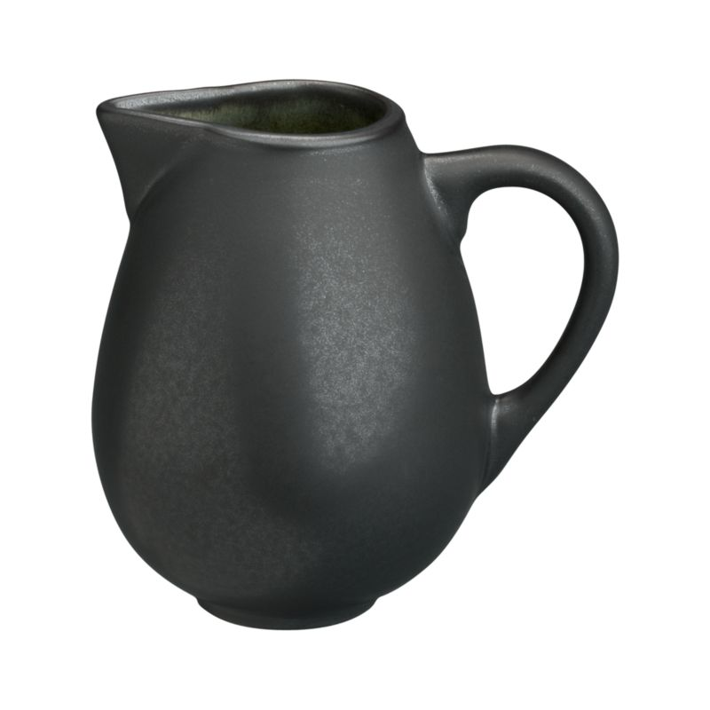"Earthy, Asian-inspired creamer is both chic and soothing in hues of black and moss green. Minimal modern styling allows the color drama to take center stage. Unique shape is both casual and elegent; the inviting reactive glaze on the interior ensures that no two pieces are exactly alike. Satin exterior finish has a ""cast iron"" appeal. Quality and integrity of design, only from one of France's original ceramic factories. Samoa dinnerware also available.<br /><br /><strong>Please note:</strong> This pattern will be discontinued in January 2013. When our current inventory is sold out, it is unlikely we will be able to obtain more.<br /><br /><NEWTAG/><ul><li>Unique shape</li><li>Dishwasher- and microwave-safe</li><li>Made in France</li></ul><br />"