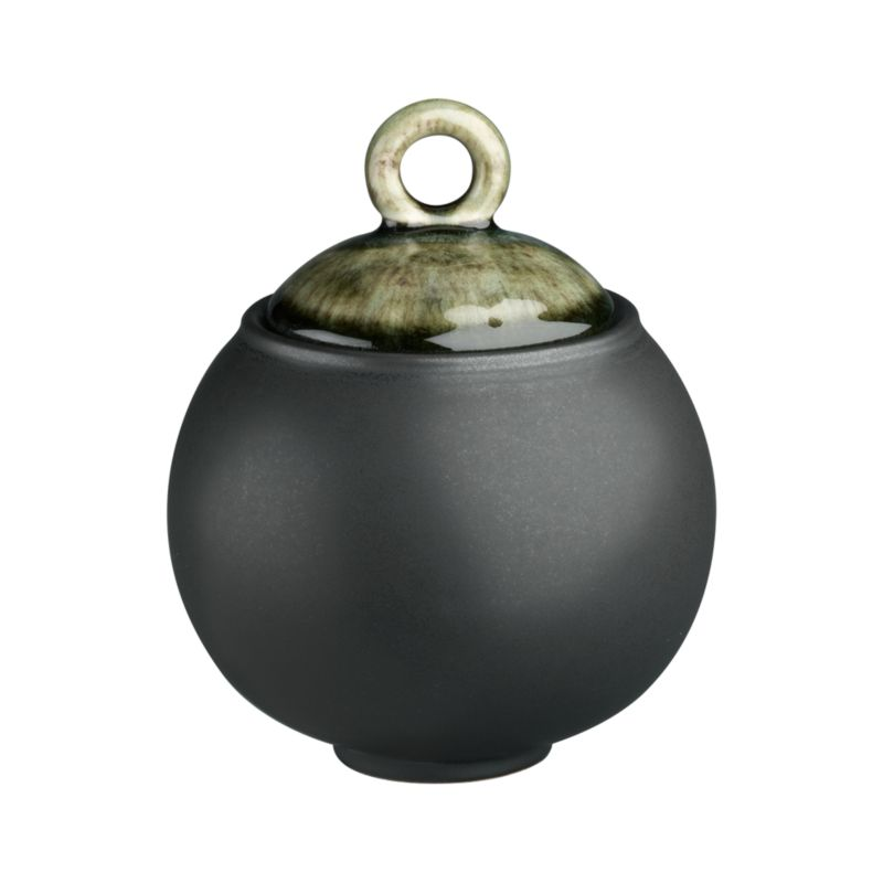 "Earthy, Asian-inspired sugar bowl is both chic and soothing in hues of black and moss green. Minimal modern styling allows the color drama to take center stage. Unique shape is both casual and elegant; the inviting reactive glaze on the lid ensures that no two pieces are exactly alike. Satin exterior finish has a ""cast iron"" appeal. Quality and integrity of design, only from one of France's original ceramic factories. Samoa dinnerware also available.<br /><br /><strong>Please note:</strong> This pattern will be discontinued in January 2013. When our current inventory is sold out, it is unlikely we will be able to obtain more.<br /><br /><NEWTAG/><ul><li>Unique shape</li><li>Dishwasher- and microwave-safe</li><li>Made in France</li></ul><br />"