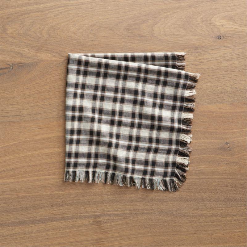 Yarn-dyed plaid threads together neutrals in a table-friendly napkin, fringed and edge-stitched on all sides.<br /><br /><NEWTAG/><ul><li>83% rayon, 12% cotton and 5% linen</li><li>Machine wash, dry flat; warm iron as needed</li><li>Made in India</li></ul>