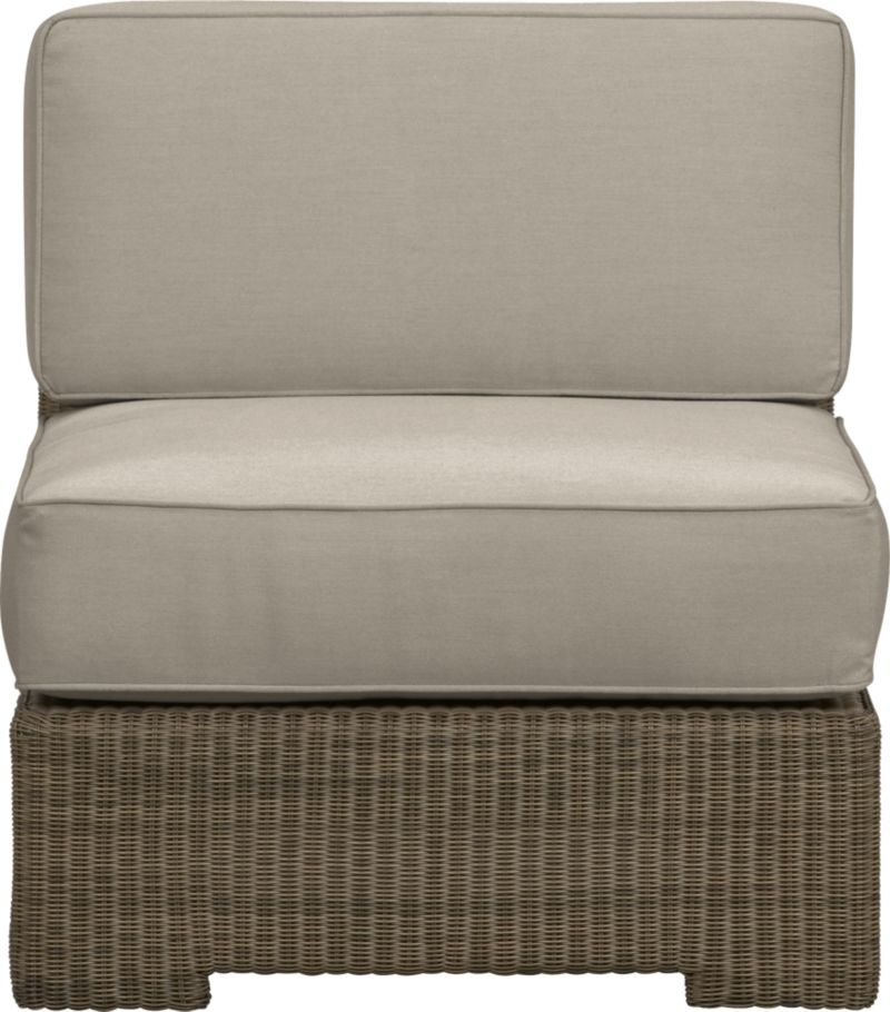 Ease into the Sanibel lounge collection. With a breezy cabana look, resort-style seating is handwoven in all-weather resin wicker with warm honey and caramel tones. Small, tight weave wraps with precision over sturdy powdercoated aluminum. Modular group configures sectional arrangements to any size outdoor space. Deep cushions with self-welt detail are covered in fade- and mildew-resistant Sunbrella acrylic in stone.<br />After you place your order, we will send a fabric swatch via next day air for your final approval. We will contact you to verify both your receipt and approval of the fabric swatch before finalizing your order.<br /><br /><NEWTAG/><ul><li>Hand-woven, fade-resistant, recyclable resin wicker</li><li>Aluminum frame with powdercoat finish</li><li>For indoor or outdoor use</li><li>Cushion is fade- and mildew-resistant Sunbrella acrylic</li><li>Spot clean cushion</li><li>Made in Indonesia and USA </li></ul>