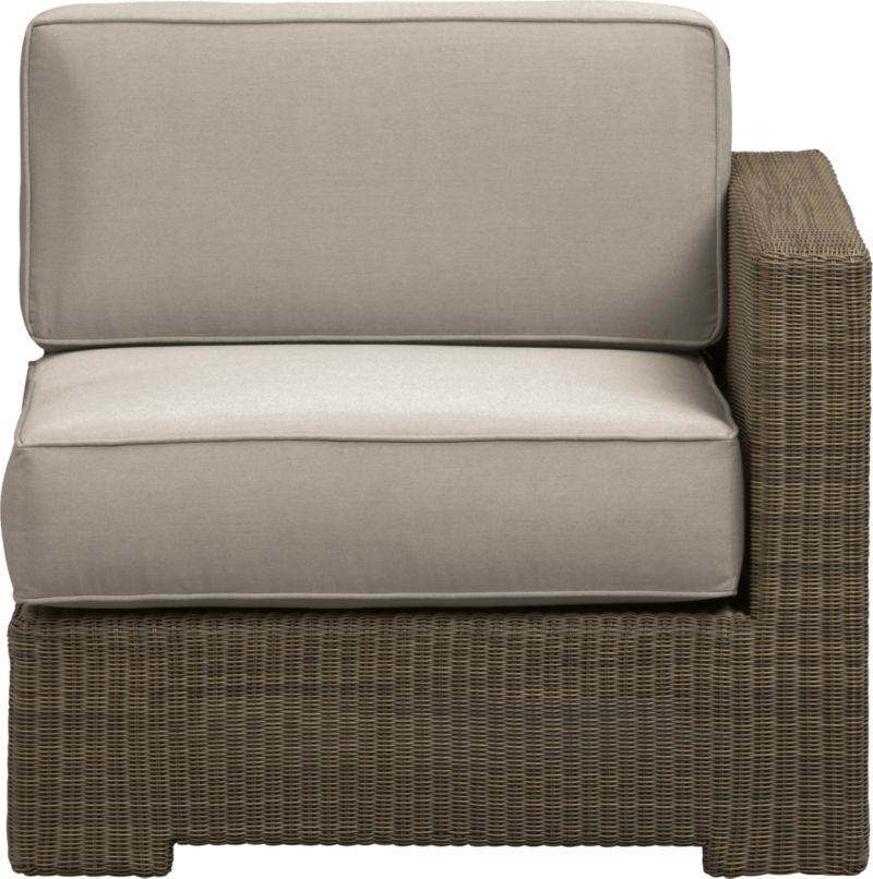 Ease into the Sanibel lounge collection. With a breezy cabana look, resort-style seating is handwoven in all-weather resin wicker with warm honey and caramel tones. Small, tight weave wraps with precision over sturdy powdercoated aluminum. Modular group configures sectional arrangements to any size outdoor space. Deep square cushions with self-welt detail are covered in fade- and mildew-resistant Sunbrella acrylic in stone.<br />After you place your order, we will send a fabric swatch via next day air for your final approval. We will contact you to verify both your receipt and approval of the fabric swatch before finalizing your order.<br /><br /><NEWTAG/><ul><li>Hand-woven, fade-resistant, recyclable resin wicker</li><li>Aluminum frame with powdercoat finish</li><li>For indoor or outdoor use</li><li>Cushion is fade- and mildew-resistant Sunbrella acrylic</li><li>Spot clean cushion</li><li>Made in Indonesia and USA </li></ul>