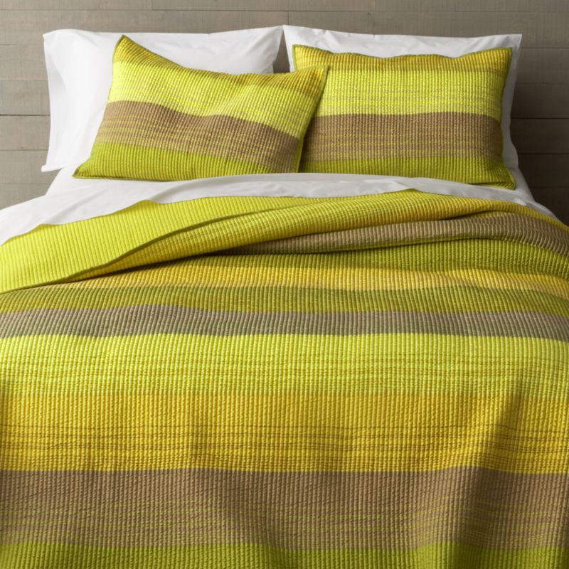 Rich desert hues of green and yellow sweep in horizontal bands, accented with hand-guided embroidery. Polyester topside brings out the sheen, reversing to solid green in soft cotton. Linens have neat self-hemmed edges.<br /><br /><NEWTAG/><ul><li>100% polyester front</li><li>100% cotton back and filling</li><li>100% rayon embroidery</li><li>Dry clean only</li><li>Made in India</li></ul>