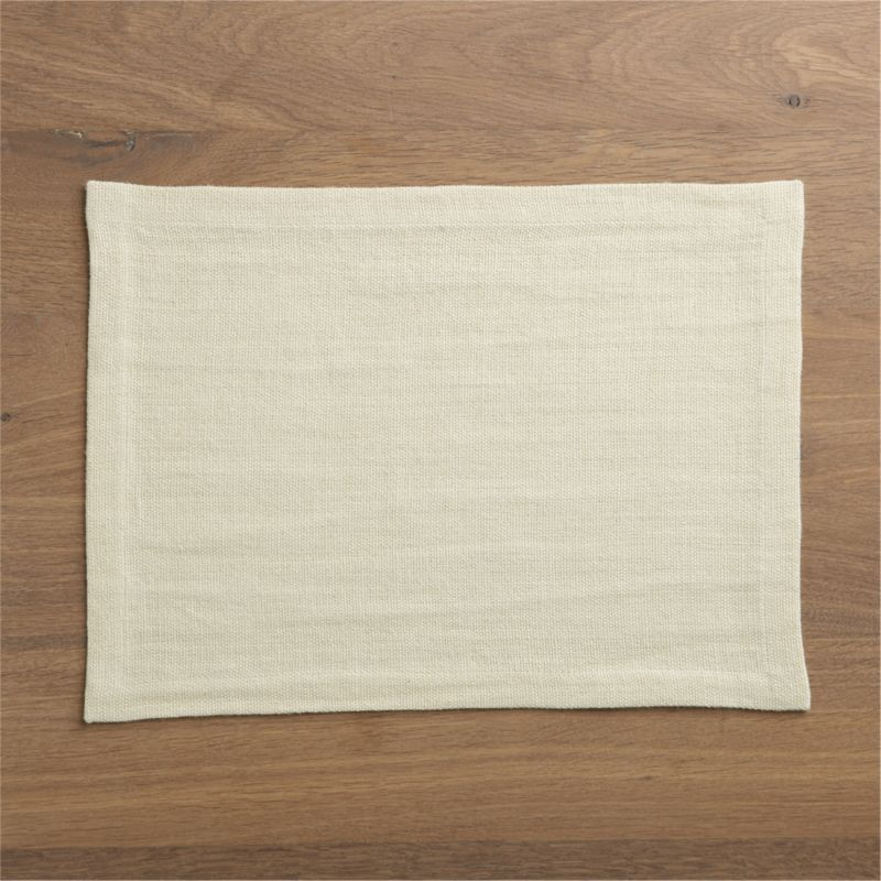 Beautiful ivory linen placemat sets a neutral, subtly textured stage, putting all kinds of dinnerware in a starring role.<br /><br /><NEWTAG/><ul><li>100% linen</li><li>Machine wash, dry flat; warm iron as needed</li><li>Made in India</li></ul>