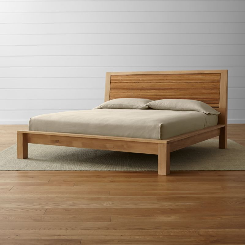 Combining the natural beauty of repurposed teak and oak in an eco-friendly union with clean, balanced proportions, our Sierra king platform bed features a textured, paneled headboard crafted from strips of teak and a solid European white oak frame. <NEWTAG/><ul><li>Solid European white oak frame finished with oil and wax</li><li>Solid, steel-brushed repurposed teak headboard finished with clear topcoat</li><li>As with all solid woods, expansion and contraction may occur with seasonal changes in humidity</li><li>13 slats with 1 center support leg</li><li>Platform bed designed for use with mattress only</li><li>Mattresses and optional bunky board available (sold separately)</li><li>Maximum weight capacity: 800 pounds (includes weight of mattress and occupants)</li><li>Made in Vietnam</li></ul>