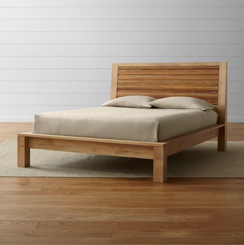 Our Sierra queen platform bed combines repurposed teak and oak's natural beauty in an eco-friendly union. A textured paneled headboard is crafted from strips of teak, salvaged from spare production materials and steel-brushed to highlight the grain's tone and texture. <NEWTAG/><ul><li>Solid European white oak frame finished with oil and wax</li><li>Solid, steel-brushed repurposed teak headboard finished with clear topcoat</li><li>As with all solid woods, expansion and contraction may occur with seasonal changes in humidity</li><li>13 slats with 1 center support leg</li><li>Platform bed designed for use with mattress only</li><li>Mattresses and optional bunky board available (sold separately)</li><li>Maximum weight capacity: 800 pounds (includes weight of mattress and occupants)</li><li>Made in Vietnam</li></ul>