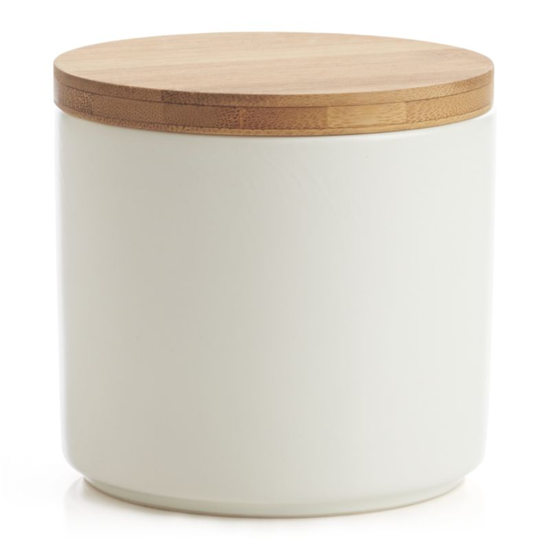 Clean, contemporary styling in durable stoneware, warmed by a winter-white glaze and natural bamboo lid. Silicone lid gasket forms a tight seal, locking in freshness and locking out moisture. Stackable canisters store staples in style on the countertop or pantry.<br /><br /><NEWTAG/><ul><li>Stoneware</li><li>Matte glaze finish</li><li>Bamboo lid with silicone gasket</li><li>BPA-free</li><li>Canister is dishwasher-safe</li><li>Hand wash the bamboo lid</li><li>Made in China</li></ul><br />