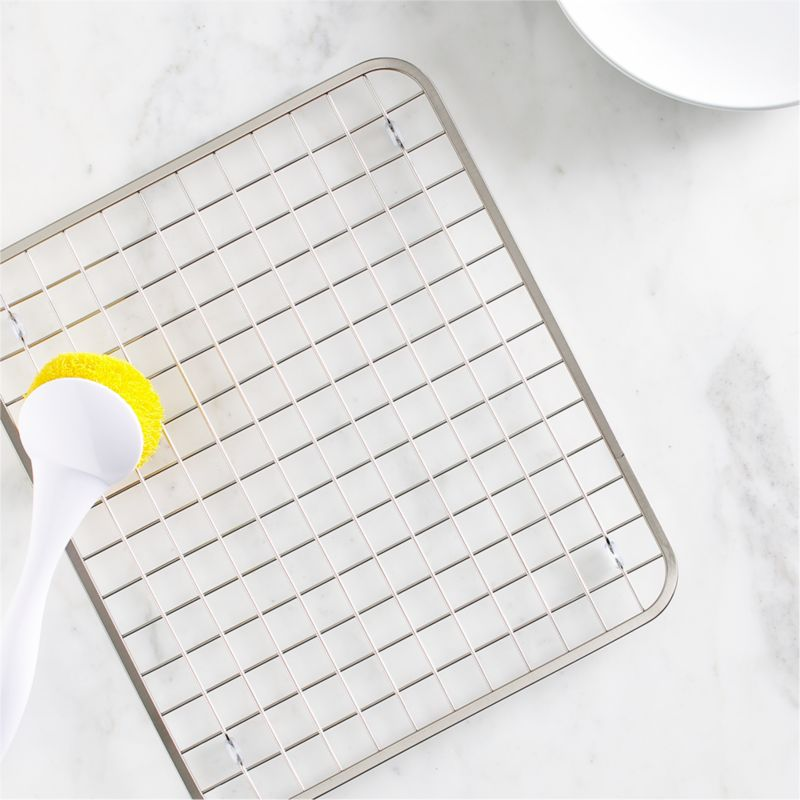 Nonslip and rustproof, this footed stainless grid with satin finish gets between the sink and the contents to limit dishwashing damage to your dinnerware, stemware, pots and sink surface.<br /><br /><NEWTAG/><ul><li>18/8 stainless steel</li><li>Satin finish</li><li>Nonslip rubber feet</li><li>Hand wash</li><li>Made in China</li></ul>