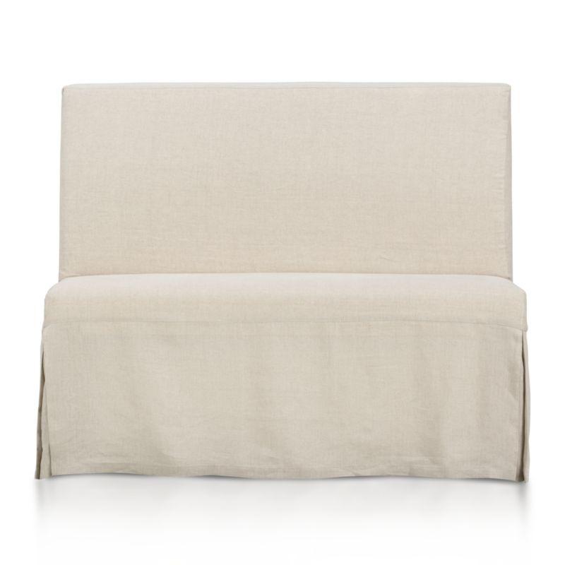 Our streamlined Slip Bench offers casual, open seating with a comfortably angled back and natural-linen slipcover. <NEWTAG/><ul><li>Solid beechwood frame</li><li>Webbing suspension system</li><li>Polyfoam cushion seat and back</li><li>Base is covered in 100 percent cotton muslin</li><li>Removable 100 percent linen slipcover</li><li>Seats 2</li><li>Made in China</li></ul><br />