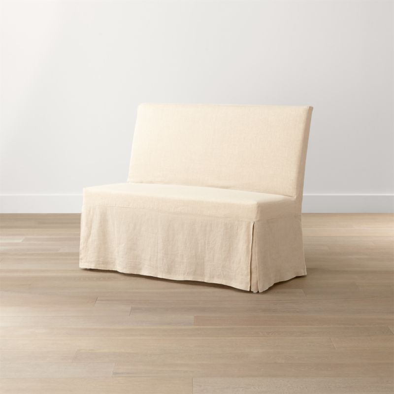 Our streamlined Slip Bench offers casual, open seating with a comfortably angled back and natural-linen slipcover. <NEWTAG/><ul><li>Solid beechwood frame</li><li>Webbing suspension system</li><li>Polyfoam cushion seat and back</li><li>Base is covered in 100 percent cotton muslin</li><li>Removable 100 percent linen slipcover</li><li>Seats 2</li><li>Made in China</li></ul><br />