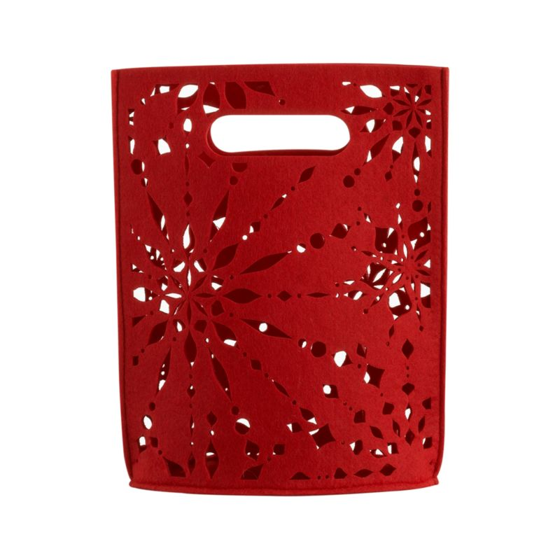 Our exclusive snowflake pattern cuts a festive flurry in red felt tote. Insert a gift or two and a puff of tissue paper for a dazzling gift to go.<br /><br /><NEWTAG/><ul><li>Polyester felt</li><li>Exclusive design</li><li>Made in China</li></ul>