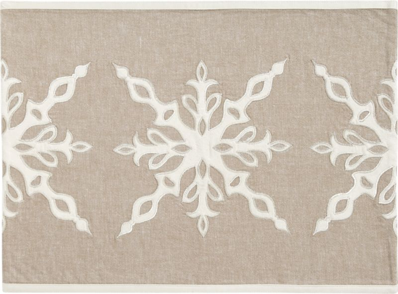 Shimmery metallic thread outlines a horizontal row of delicate snowflake appliqués, stencil-cut and embroidered on neutral cotton chambray.  An understated, elegant option for the holiday table.<br /><br /><NEWTAG/><ul><li>100 % cotton</li><li>100 % polyester appliqué</li><li>Rayon/metallic embroidery</li><li>Machine wash placemat cold, gentle cycle; do not bleach</li><li>Made in India</li></ul>