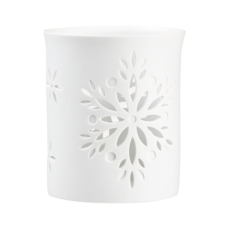 "Elegant white porcelain luminaries scatter candlelight through lacy cutouts of fanciful floral snowflakes.<br /><br /><NEWTAG/><ul><li>Porcelain</li><li>Accommodates up to 3""-dia. pillar candle, sold separately</li><li>Made in China</li></ul>"