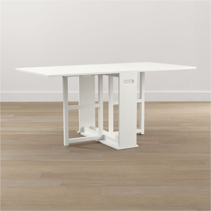 """An ingenious classic for modern times, our slender gateleg table opens to a generous 65½"""" wide accommodate up to four guests, then folds up to a slim 9½"""" wide to stow away until your next gathering. Compact design can also function as a sleek console against a wall. Wood construction with an oak veneer tabletop and semigloss white lacquer finish.<br /><br /><a href=""""/Assembly-Instructions/English/Span_Gateleg_Table.pdf"""">Important operational instructions (PDF format).</a><br /><br /><NEWTAG/><ul><li>Tabletop is oak veneer and low-emission engineered wood with solid rubberwood edge banding</li><li>Frame and legs are sustainable solid rubberwood</li><li>Semigloss white lacquer finish</li><li>Seats up to four</li><li>Made in China</li></ul>"""