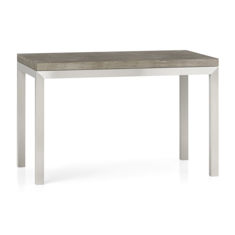 "You've designed your ideal table, from top to bottom in just the right size. The warm grey concrete top is a mix of marble, stone and granite powders with natural fibers for added strength. This industrial, modern surface is handmade in an eco-friendly shop powered without fossil fuels. Due to the handmade nature of the concrete mix, color will vary and may change over time. To complement its clean, simple lines, the stainless steel Parsons-style frame gets a soft, contemporary brushed finish that mimics mitered wood corners. Perfect for kitchens and smaller spaces, this table seats up to 4. The Concrete Top/Parsons Stainless Steel Base 48""x28"" Dining Table is a Crate and Barrel exclusive.<br /><br /><NEWTAG/><ul><li>Handmade concrete top of stone, marble, granite and natural fibers</li><li>Hairline fractures and slight tolerance for fit to base are characteristics of the concrete</li><li>Stainless steel base with brushed finish</li><li>Foot caps</li><li>Seats 4</li><li>Made in Vietnam and China </li></ul>"