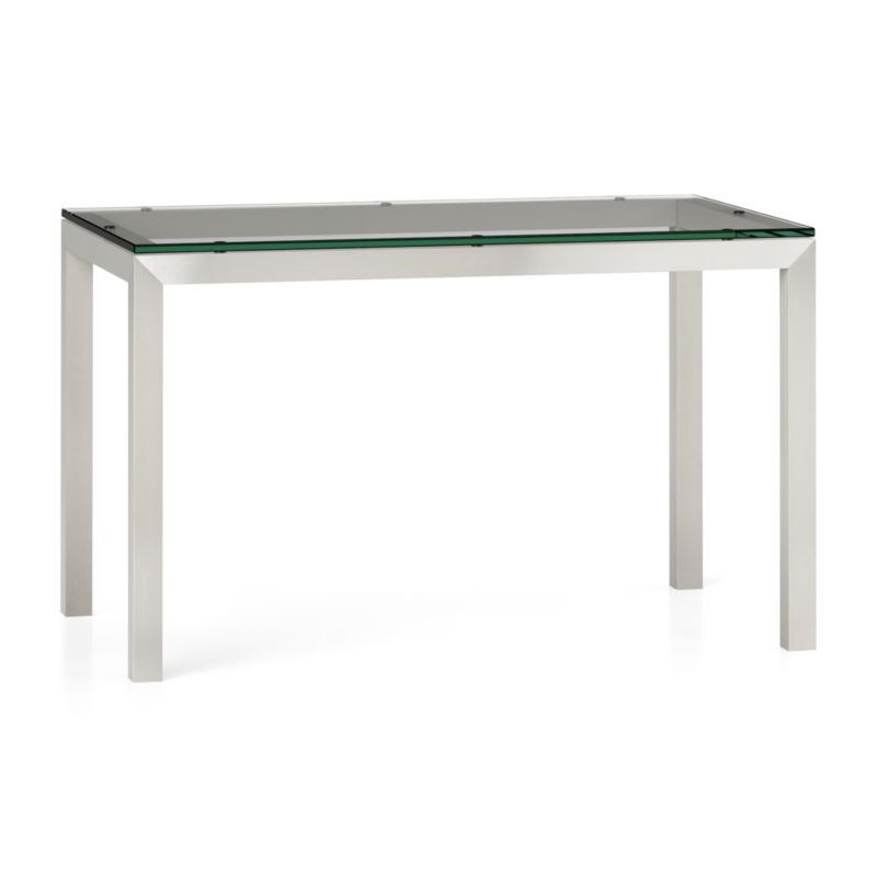 "You've designed your ideal table, from top to bottom in just the right size. Clear float glass makes a transparent top that's ⅝-inch thick with a flat, polished edge. To complement its clean, simple lines, this stainless steel Parsons-style frame gets a soft, contemporary brushed finish that mimics mitered wood corners. Perfect for kitchens and smaller spaces, this table seats up to 4. The Clear Glass Top/Parsons Stainless Steel Base 48""x28"" Dining Table is a Crate and Barrel exclusive.<br /><br /><NEWTAG/><ul><li>⅝"" glass top with flat polished edge</li><li>Non-tempered glass</li><li>Stainless steel base with brushed finish</li><li>Foot caps</li><li>Seats 4</li><li>Made in China</li></ul>"