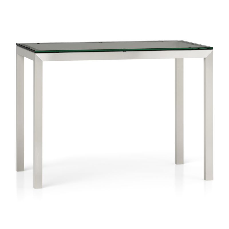 "You've designed your ideal table, from top to bottom in just the right size. Clear float glass makes a transparent top that's ⅝-inch thick with a flat, polished edge. To complement its clean, simple lines, this stainless steel Parsons-style frame gets a soft, contemporary brushed finish that mimics mitered wood corners. Counter-height high dining table seats up to 4. The Clear Glass Top/Parsons Stainless Steel Base 48""x28"" High Dining Table is a Crate and Barrel exclusive.<br /><br /><NEWTAG/><ul><li>⅝"" glass top with flat polished edge</li><li>Non-tempered glass</li><li>Stainless steel base with brushed finish</li><li>Foot ca"