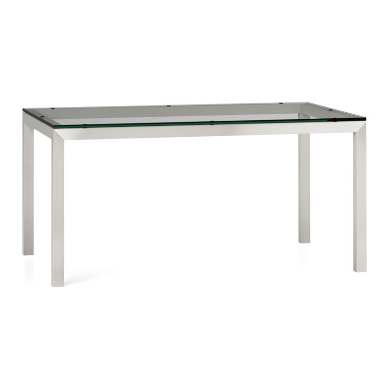 """You've designed your ideal table, from top to bottom in just the right size. Clear float glass makes a transparent top that's ⅝-inch thick with a flat, polished edge. To complement its clean, simple lines, this stainless steel Parsons-style frame gets a soft, contemporary brushed finish that mimics mitered wood corners. Sized to seat up to 6, this table is perfect for everyday dining or entertaining. The Clear Glass Top/Parsons Stainless Steel Base 60""""x36"""" Dining Table is a Crate and Barrel exclusive.<br /><br /><NEWTAG/><ul><li>⅝"""" glass top with flat polished edge</li><li>Non-tempered glass</li><li>Stainless steel base with brushed finish</li><li>Foot caps</li><li>Seats 6</li><li>Made in China</li></ul>"""