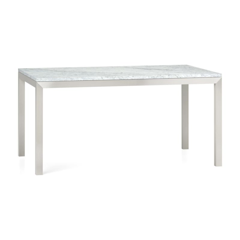 "You've designed your ideal table, from top to bottom in just the right size. The polished Italian Carrara marble top displays the unique markings and color variations of pure, unfinished stone. To complement its clean, simple lines, this stainless steel Parsons-style frame gets a soft, contemporary brushed finish that mimics mitered wood corners. Sized to seat up to 6, this table is perfect for everyday dining or entertaining. The Marble Top/Parsons Stainless Steel Base 60""x36"" Dining Table is a Crate and Barrel exclusive.<br /><br /><NEWTAG/><ul><li>Polished Italian Carrara marble top over honeycomb aluminum core to reduce weight and limit cracking</li><li>Slight tolerance for fit to base is characteristic of the marb"