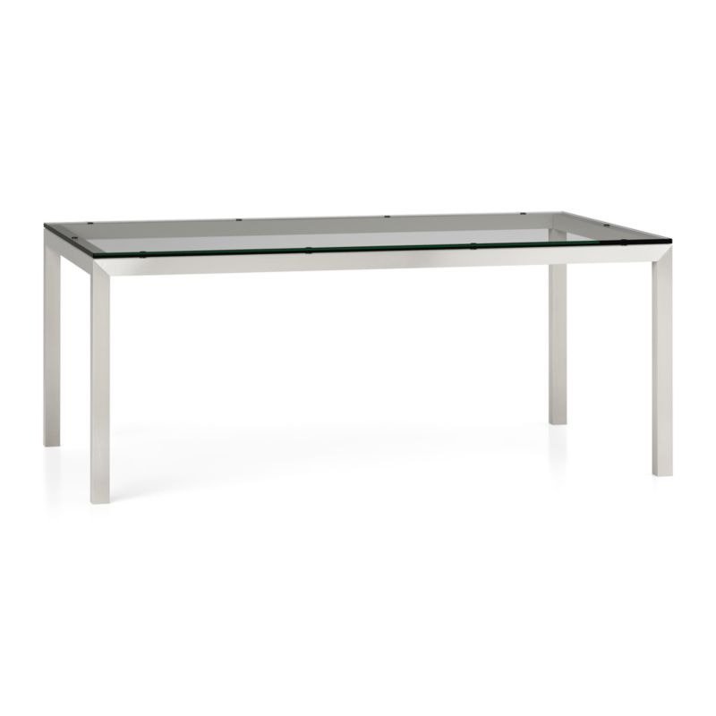 """You've designed your ideal table, from top to bottom in just the right size. Clear float glass makes a transparent top that's ⅝-inch thick with a flat, polished edge. To complement its clean, simple lines, this stainless steel Parsons-style frame gets a soft, contemporary brushed finish that mimics mitered wood corners. Generously sized table is great for entertaining, seating up to 8. The Clear Glass Top/Parsons Stainless Steel Base 72""""x42"""" Dining Table is a Crate and Barrel exclusive.<br /><br /><NEWTAG/><ul><li>⅝"""" glass top with flat polished edge</li><li>Non-tempered glass</li><li>Stainless steel base with brushed finish</li><li>Foot caps</li><li>Seats 8</li><li>Made in China</li></ul>"""