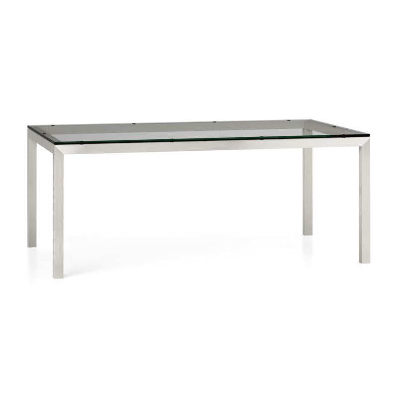 "You've designed your ideal table, from top to bottom in just the right size. Clear float glass makes a transparent top that's ⅝-inch thick with a flat, polished edge. To complement its clean, simple lines, this stainless steel Parsons-style frame gets a soft, contemporary brushed finish that mimics mitered wood corners. Generously sized table is great for entertaining, seating up to 8. The Clear Glass Top/Parsons Stainless Steel Base 72""x42"" Dining Table is a Crate and Barrel exclusive.<br /><br /><NEWTAG/><ul><li>⅝"" glass top with flat polished edge</li><li>Non-tempered glass</li><li>Stainless steel base with brushed finish</li><li>Foot caps</li><li>Seats 8</li><li>Made in China</li></ul>"