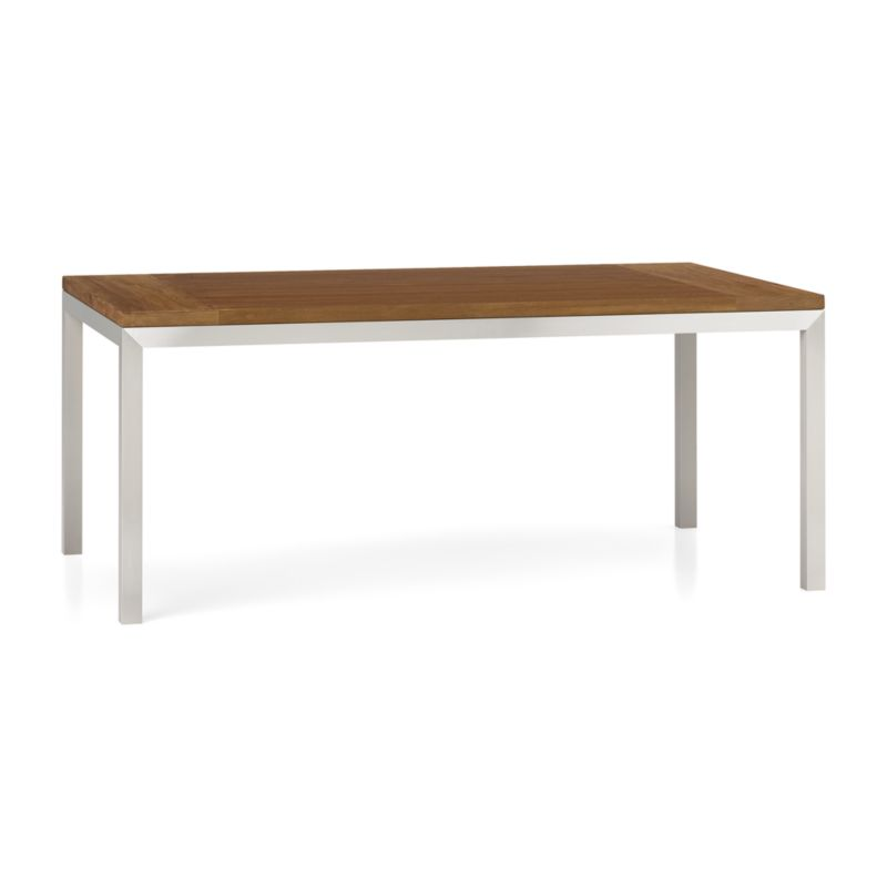 "You've designed your ideal table, from top to bottom in just the right size. This 1 ½""-thick layered wood top is handcrafted from repurposed teak sourced in Southeast Asia, with breadboard construction to allow for seasonal movement.Variations in wood grain, texture and color, knots and other naturally occurring characteristics add to the wood's distinct character. To complement its clean, simple lines, the stainless steel Parsons-style frame gets a soft, contemporary brushed finish that mimics mitered wood corners. Generously sized table is great for entertaining, seating up to 8. The Teak Top/Parsons Stainless Steel Base 72""x42"" Dining Table is a Crate and Barrel exclusive.<br /><br /><NEWTAG/><ul><li>Reclaimed, unfinished layered teak tabletop</li><li>Naturally occurring color, texture and knots</li><li>Stainless steel base with brushed finish</li><li>Foot caps</li><li>Seats 8</li><li>Made in China and Indonesia </li></ul>"