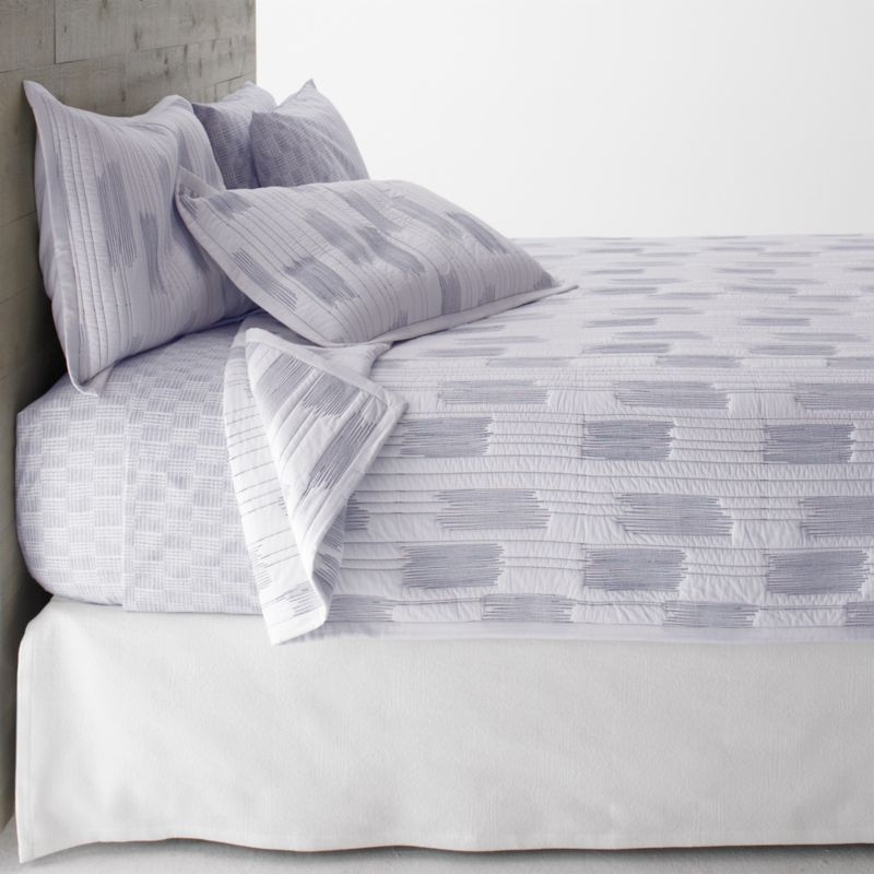 Thin blue line tracks fine lines and occasional zigzag blocks on crisp white cotton for a fresh and contemporary bed. Reverses to self and is cotton-filled, perfect on its own or layered for added warmth.<br /><br /><NEWTAG/><ul><li>100% cotton</li><li>100% cotton fill</li><li>Machine wash, tumble dry low</li><li>Made in India</li></ul>