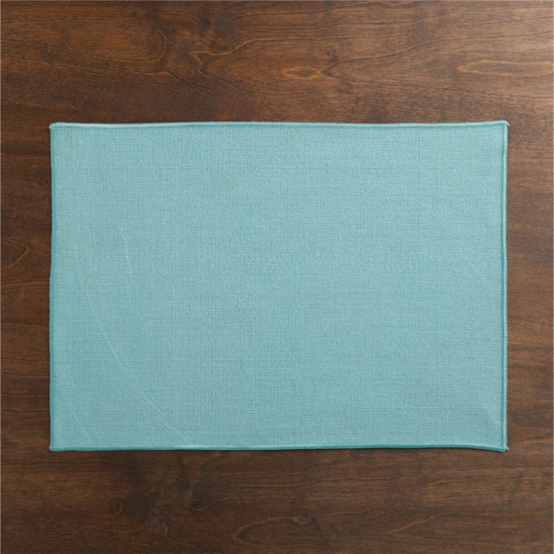 Surged edges give this no-fuss, solid blue placemat a clean finish.<br /><br /><NEWTAG/><ul><li>62% linen and 38% cotton</li><li>Machine wash cold, line dry; warm iron as needed</li><li>Oversized to allow for shrinkage</li><li>Made in India</li></ul>