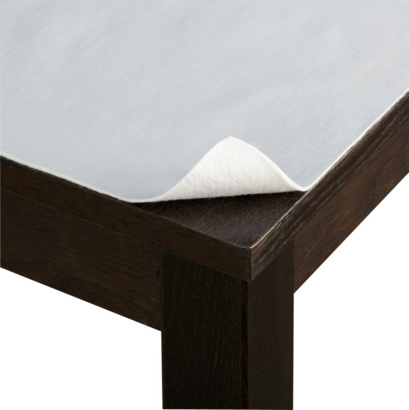 Concealed beneath table linens, our grey PEVA pad with embossed texture is liquid-proof and prevents dings and scratches. Pad cuts to fit and protect almost any table, stores in its reusable pouch.<br /><br /><NEWTAG/><ul><li>PEVA with polyester backing</li><li>Clean top with soap and water; spot clean reverse</li><li>Trim to fit</li><li>Made in USA</li></ul>