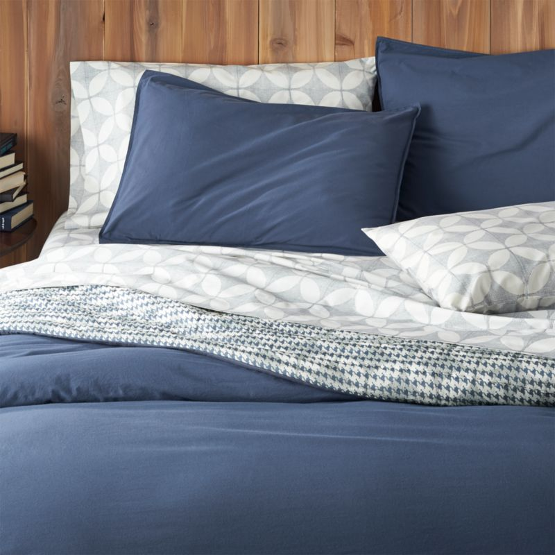 Soft, casual stonewashed cotton linens embrace the bed in a gorgeous shade of blue, a perfect solid for mixing and matching with our print collections. Duvet is detailed with double-needle stitching and has a hidden-button closure and interior fabric ties to stabilize duvet insert. Duvet inserts also available.<br /><br /><NEWTAG/><ul><li>100% cotton percale</li><li>200-thread-count</li><li>Machine wash cold; tumble dry low; warm iron as needed</li><li>Do not bleach</li><li>Hidden button closure and interior fabric ties</li><li>Made in Portugal</li></ul>
