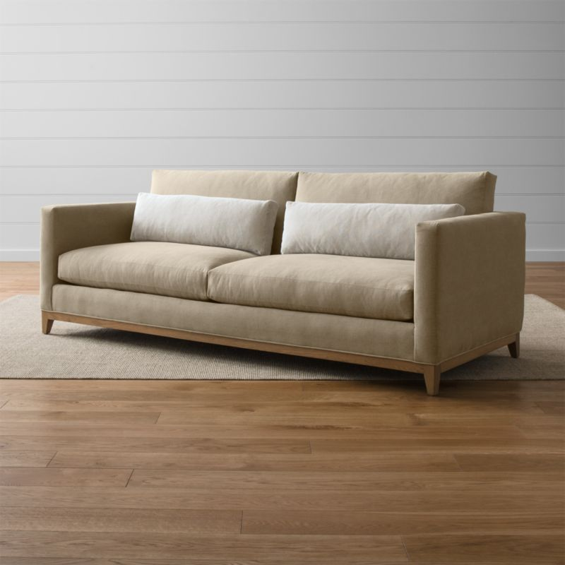 Our Taraval 2-seat sofa relaxes all conventions about what a living room sofa can be. Casual, yet elegant, it's upholstered in all-natural cotton with stonewashed 100% linen kidney cushions lofted with down to hug your lower back in comfort. <NEWTAG/><ul><li>Frame is benchmade in the USA with eco-friendly, certified sustainable hardwood that's kiln-dried to prevent warping</li><li>Solid oak legs and base in a weathered grey finish</li><li>Eight-way, hand-tied spring suspension system</li><li>Soy-based polyfoam seat cushions with innerspring coil system, wrapped in polyfiber and feather-down blend and encased in downproof ticking</li><li>Polyfiber and feather-down blend back cushions and kidney pillows encased in downproof ticking</li><li>Includes 2 kidney pillows</li><li>Material origin: see swatch</li><li>Made in North Carolina, USA</li></ul>